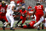 FILE - In this Sept. 15,2018, file photo, Maryland quarterback Tyrrell Pigrome, center, rushes the ball in the first half of an NCAA college football game against Temple, in College Park, Md. Maryland interim coach Matt Canada has used both his quarterbacks in all five games this season, jockeying between Kasim Hill and Tyrrell Pigrome in an unyielding effort to get more production from an offense that has relied far too heavily on the run.(AP Photo/Patrick Semansky, File)