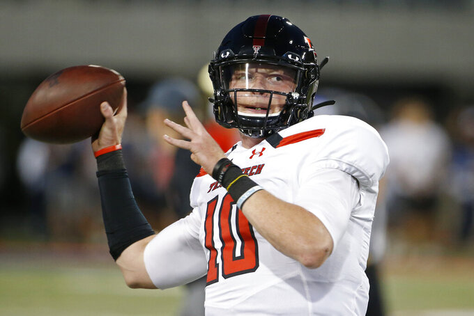 Texas Tech quarterback Alan Bowman (10) warms up prior to an NCAA college football game against Arizona, Saturday, Sept. 14, 2019, in Tucson, Ariz. Texas quarterback Sam Ehlinger lost his top receiving targets from a year ago but has found plenty of options so far in 2020. The No. 8 Longhorns spread around seven touchdowns to seven different receivers in their first game. Now they go on the road to open Big 12 play against Texas Tech. Bowman was one of the top freshman quarterbacks in the country in 2018 only to have part of that season and much of 2019 wiped out by injuries. He's back and threw for 430 yards against Houston Baptist. (AP Photo/Ralph Freso)