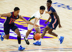 Norfolk State's Devante Carter, center, drives past Morgan State's Tahj-Malik Campbell, left, and Malik Miller, right, during the first half of of an NCAA college basketball game in the championship of the Mid-Eastern Athletic Conference tournament at the Scope Arena on Saturday, March 13, 2021, in Norfolk, Va. (AP Photo/Mike Caudill)