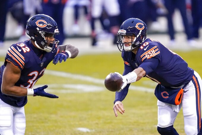 Chicago Bears' Mitchell Trubisky hands off to David Montgomery during the first half of an NFL football game against the Green Bay Packers Sunday, Jan. 3, 2021, in Chicago. (AP Photo/Charles Rex Arbogast)