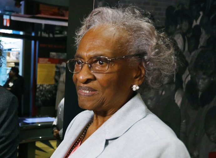 File - In this Nov. 10, 2017 photograph, Ellie Dahmer, wife of Vernon Dahmer of Hattiesburg, who was killed in 1966 by the Ku Klux Klan, views the exhibits at the Mississippi Civil Rights Museum during a private preview, in Jackson, Miss. The University of Southern Mississippi is awarding an honorary degree to Dahmer, who worked alongside her husband to register African American voters during some of the most violent years of segregation. (AP Photo/Rogelio V. Solis, File)