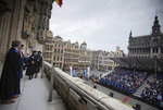 Two sisters, both engineering graduates of the Universite Libre De Bruxelles, walk across the balcony of the Gothic town hall during a graduation ceremony at the Grand Place in Brussels, Wednesday, Sept. 30, 2020. Many of these students were supposed to graduate in June, but with exams cancelled and COVID-19 regulations in place many students were unable to manage that in time. Pandemic restrictions limited the guest invitations to only 2 persons for each graduate. (AP Photo/Virginia Mayo)