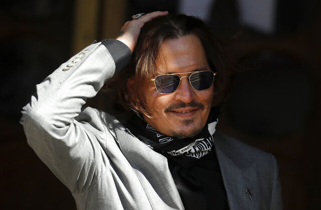 "FILE - In this file photo dated Tuesday, July 28, 2020, US Actor Johnny Depp arrives at the High Court in London during his case against News Group Newspapers over a story published about his former wife Amber Heard, which branded him a 'wife beater'.  A British judge is set to deliver his judgement in writing on Monday Nov. 2, 2020, deciding whether a tabloid newspaper defamed Depp by calling him a ""wife beater."