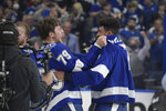 Tampa Bay Lightning left wing Ross Colton (79) celebrates with right wing Mathieu Joseph (7) after the Lighting defeated the Montreal Canadiens 1-0 in Game 5 of the NHL hockey Stanley Cup finals, Wednesday, July 7, 2021, in Tampa, Fla. (AP Photo/Phelan Ebenhack)