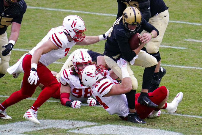 Purdue quarterback Jack Plummer (13) is sacked by Nebraska linebacker Garrett Nelson (44) during the first quarter of an NCAA college football game in West Lafayette, Ind., Saturday, Dec. 5, 2020. (AP Photo/Michael Conroy)