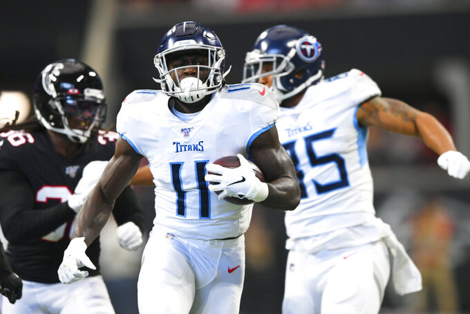 Tennessee Titans wide receiver A.J. Brown (11) runs into the end zone for a touchdown against the Atlanta Falcons during the first half of an NFL football game, Sunday, Sept. 29, 2019, in Atlanta. (AP Photo/John Amis)