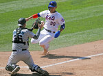 Miami Marlins catcher Ryan Lavarnway, left, prepares to tag out New York Mets' Michael Conforto (30) at the plate during the fifth inning of a baseball game at Citi Field, Sunday, Aug. 9, 2020, in New York. (AP Photo/Kathy Willens)