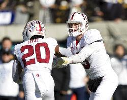 Stanford quarterback K.J. Costello (3) hands off toe running back Bryce Love (20) against the California  in the first quarter of a football game in Berkeley, Calif., Saturday, Dec. 1, 2018. (AP Photo/John Hefti)