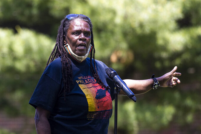 In this May 15, 2021 photo, Consuewella Africa, 69, speaks during a gathering for the 36th Anniversary of the MOVE Bombing in Philadelphia. Consuewella Dotson Africa, a longtime member of the Black organization MOVE and mother of two children killed in the 1985 bombing of the group's home in Philadelphia, died on Wednesday, June 16, 2021 in a hospital. She was 67. (Tyger Williams/The Philadelphia Inquirer via AP)