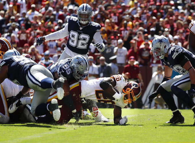 Washington Redskins running back Adrian Peterson (26) scores a touchdown against the Dallas Cowboys in the first half of an NFL football game, Sunday, Sept. 15, 2019, in Landover, Md. (AP Photo/Alex Brandon)