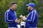 Team Europe captain Padraig Harrington talks to Team Europe's Shane Lowry during a practice day at the Ryder Cup at the Whistling Straits Golf Course Tuesday, Sept. 21, 2021, in Sheboygan, Wis. (AP Photo/Charlie Neibergall)
