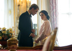"In this image released by Netflix, Claire Foy as Queen Elizabeth II, right, and Matt Smith as Prince Philip in a scene from ""The Crown."" Britain's Prince Philip stood loyally behind behind Queen Elizabeth, as his character does on Netflix's ""The Crown."" But how closely does the TV character match the real prince, who died Friday, April 9, 2021 at 99? Philip is depicted as a man of action in ""The Crown,"" and he served with distinction in the navy in World War II. He was also an avid yachtsman and polo player. (Robert Viglasky/Netflix via AP)"