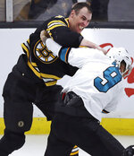 Boston Bruins defenseman Zdeno Chara, left, lands a punch during a fight with San Jose Sharks left wing Evander Kane (9) during the third period of an NHL hockey game in Boston, Tuesday, Feb. 26, 2019. (AP Photo/Charles Krupa)