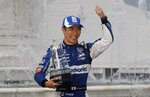 Takuma Sato, of Japan, waves after receiving the third place trophy after the first race of the IndyCar Detroit Grand Prix auto racing doubleheader, Saturday, June 1, 2019, in Detroit. (AP Photo/Carlos Osorio)