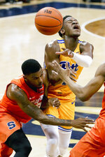 Pittsburgh's Xavier Johnson, right, and Syracuse's Frank Howard, left, collide during the first half of an NCAA college basketball game, Saturday, Feb. 2, 2019, in Pittsburgh. (AP Photo/Keith Srakocic)