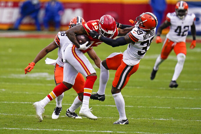 Kansas City Chiefs wide receiver Byron Pringle (13) is tackled by Cleveland Browns cornerback Terrance Mitchell (39) after catching a pass during the first half of an NFL divisional round football game, Sunday, Jan. 17, 2021, in Kansas City. (AP Photo/Jeff Roberson)
