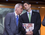 House Majority Leader Kevin McCarthy, R-Calif., and Speaker of the House Paul Ryan, R-Wis., confer during a news conference following a closed-door GOP meeting on immigration, on Capitol Hill in Washington, Wednesday, June 13, 2018. Ryan says compromise legislation is in the works on immigration that has an