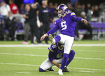 "FILE - In this Oct. 28, 2018, file photo, Minnesota Vikings kicker Dan Bailey warms up before an NFL football game against the New Orleans Saints in Minneapolis. Coach Mike Zimmer said he was ""at a loss"" about his specialists, after Kaare Vedvik missed two field goals in the last exhibition game. With four days left before roster reduction day, the Vikings still don't have clarity about whether kicker Dan Bailey and punter Matt Wile will stay or if Vedvik will replace one of them. (AP Photo/Jim Mone, File)"