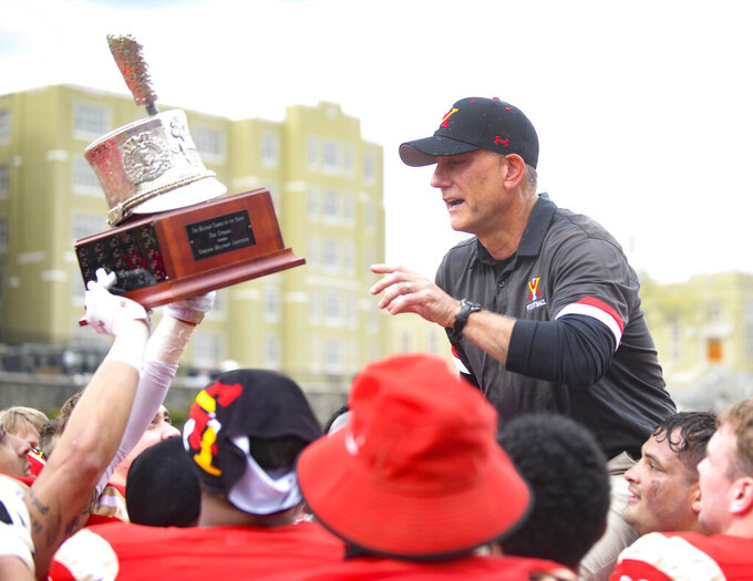 VMI head coach Scott Wachenheim is lifted up by his team after they defeated The Citadel 31-17 to win the Southern Conference Championship, Saturday, April 17, 2021, in Lexington, Va. (David Hungate/Roanoke Times via AP)