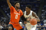 Penn State's Izaiah Brockington (12) drives the baseline on Illinois' Alan Griffin (0) during the first half of an NCAA college basketball game Tuesday, Feb. 18, 2020, in State College, Pa. (AP Photo/Gary M. Baranec)