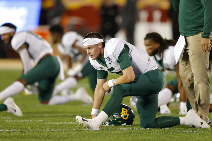 Baylor quarterback Charlie Brewer and teammates warm up for an NCAA college football game against Iowa State, Saturday, Nov. 7, 2020, in Ames, Iowa. (AP Photo/Matthew Putney)