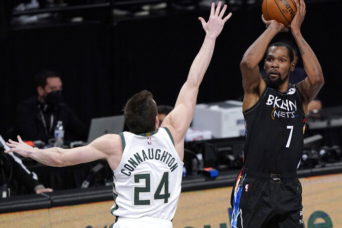 Brooklyn Nets forward Kevin Durant (7) shoots as Milwaukee Bucks guard Pat Connaughton (24) defends during the fourth quarter of Game 5 of a second-round NBA basketball playoff series Tuesday, June 15, 2021, in New York. (AP Photo/Kathy Willens)