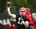 Georgia quarterback Jake Fromm (11) throws a pass during their NCAA college football training camp practice Friday, Aug. 3, 2018 in Athens, Ga. (AP Photo/John Bazemore)