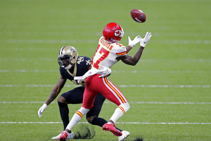 Kansas City Chiefs wide receiver Mecole Hardman (17) tries to pull in a pass against New Orleans Saints defensive back J.T. Gray (48) in the second half of an NFL football game in New Orleans, Sunday, Dec. 20, 2020. (AP Photo/Brett Duke)