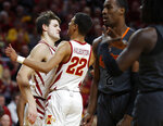Iowa State forward Michael Jacobson, left, bumps chest with Iowa State guard Tyrese Haliburton, center, after Jacobson was fouled on a shot during the first half of an NCAA college basketball game against Oklahoma State, Saturday, Jan. 19, 2019, in Ames. (AP Photo/Matthew Putney)