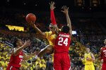 Michigan guard Zavier Simpson (3) drives on Ohio State forward Andre Wesson (24) in the second half of an NCAA college basketball game in Ann Arbor, Mich., Tuesday, Feb. 4, 2020. (AP Photo/Paul Sancya)