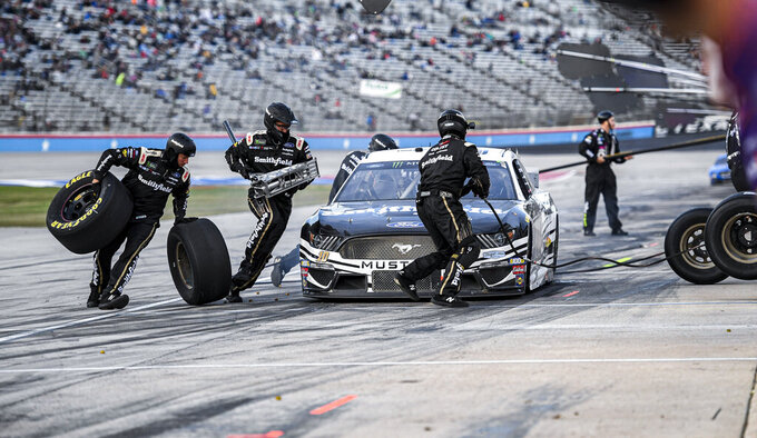 Aric Almirola's (10) pit crew services his car during a NASCAR Cup Series auto race at Texas Motor Speedway, Sunday, Nov. 3, 2019, in Fort Worth, Texas. (AP Photo/Larry Papke)