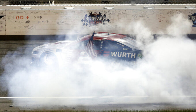 Brad Keselowski does a burnout after winning the NASCAR Cup Series auto race at Kansas Speedway in Kansas City, Kan., Saturday, May 11, 2019. (AP Photo/Colin E. Braley)