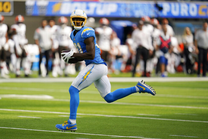 Los Angeles Chargers wide receiver Mike Williams makes a touchdown catch during the first half of an NFL football game against the Cleveland Browns Sunday, Oct. 10, 2021, in Inglewood, Calif. (AP Photo/Gregory Bull)