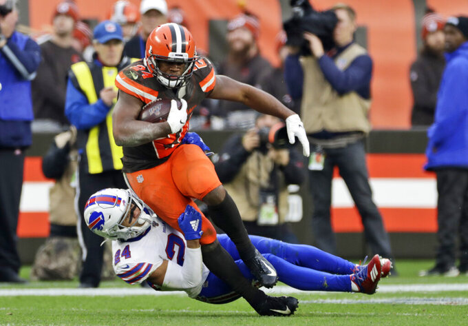 Cleveland Browns running back Nick Chubb, top, is tackled by Buffalo Bills cornerback Taron Johnson during the second half of an NFL football game, Sunday, Nov. 10, 2019, in Cleveland. (AP Photo/Ron Schwane)