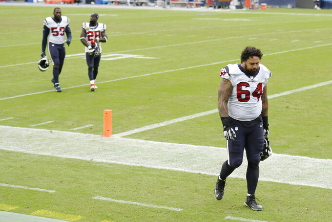 Houston Texans offensive guard Senio Kelemete (64) leaves the field after the Texans lost to the Tennessee Titans 42-36 in overtime of an NFL football game Sunday, Oct. 18, 2020, in Nashville, Tenn. (AP Photo/Mark Zaleski)