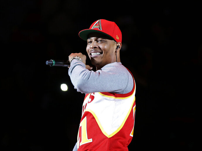 FILE - In this Nov. 1, 2014, file photo, rapper T.I. performs before the start of an NBA basketball game between the Indiana Pacers and the Atlanta Hawks in Atlanta. A New York lawmaker wants to ban tests aimed at determining virginity in response to remarks by the rapper earlier this month in which he said he has a gynecologist check his daughter's hymen annually. (AP Photo/David Goldman, File)