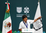 Former Bolivian President Evo Morales delivers his address after he was decorated with a distinguished citizen medal at City Hall in Mexico City, Wednesday, Nov. 13, 2019. Mexico granted asylum to Morales, who resigned on Nov. 10 under mounting pressure from the military and the public after his re-election victory triggered weeks of fraud allegations and deadly protests. (AP Photo/Eduardo Verdugo)