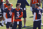 FILE - Denver Broncos quarterback Drew Lock, center, jokes with backup quarterbacks Jeff Driskel, left, and Brett Rypien during an NFL football practice in Englewood, Colo., in this Monday, Aug. 31, 2020, file photo. The Broncos activated three quarterbacks—starter Lock and backups Rypien and Blake Bortles—from the COVID-19 list Tuesday, Dec. 1, 2020, to insure that the team will not be without quarterbacks on the roster for the game against the Chiefs in Kansas City on Sunday as the Broncos were last Sunday when hosting the New Orleans Saints. (AP Photo/David Zalubowski, File)