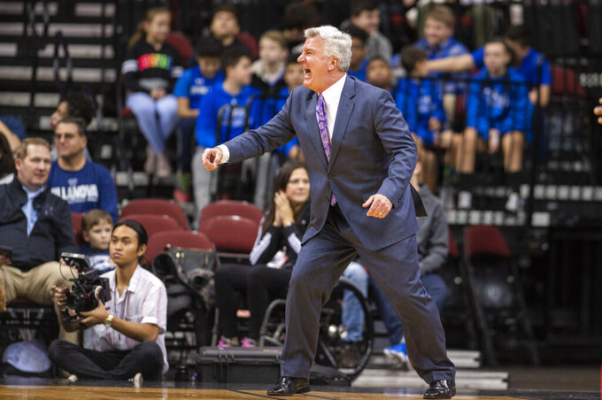 Kansas State head coach Bruce Weber reacts during the first half of the Never Forget Tribute Classic NCAA college basketball game against Mississippi State, Saturday, Dec. 14, 2019, in Newark, N.J. (AP Photo/Corey Sipkin)