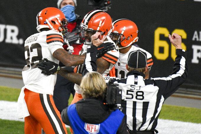 Cleveland Browns wide receiver Jarvis Landry, center, celebrates after scoring during the first half of an NFL wild-card playoff football game against the Pittsburgh Steelers in Pittsburgh, Sunday, Jan. 10, 2021. (AP Photo/Don Wright)