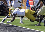 Notre Dame's Tony Jones Jr. (6) dives over the gaol line for a touchdown against Wake Forest in the first half of an NCAA college football game in Winston-Salem, N.C., Saturday, Sept. 22, 2018. (AP Photo/Chuck Burton)