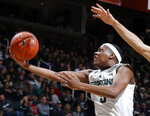 FILE - In this Dec. 16, 2018, file photo, Michigan State's Cassius Winston puts up a layup against Green Bay during the first half of an NCAA college basketball game, in East Lansing, Mich. Winston was named the Big Ten Conference Player of the Year, Tuesday, March 2, 2019. (AP Photo/Al Goldis, File)
