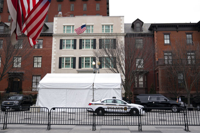 In this Jan. 25, 2021 photo, Secret Service vehicles parked outside of Blair House in Washington.  Blair House, the official government guest house, is serving as a temporary home for Vice President Kamala Harris. Vice presidents have an official residence on the grounds of Washington's Naval Observatory.  Harris  (AP Photo/Evan Vucci)