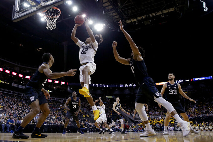Missouri guard Dru Smith (12) shoots during the first half of an NCAA college basketball game against Butler, Monday, Nov. 25, 2019, in Kansas City, Mo. (AP Photo/Charlie Riedel)