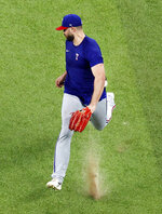 Texas Rangers outfielder Joey Gallo tries to field a fly ball on the hop during a