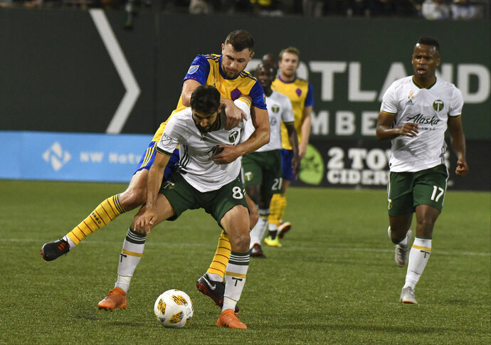 Portland Timbers' Diego Valeri (8) fights for possession against a Colorado Rapids player during an MLS soccer match Saturday, Sept. 8, 2018, in Portland, Ore. (Kent Frasure/The Oregonian via AP)