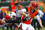 Cincinnati Bengals quarterback Andy Dalton (14) runs the ball against Arizona Cardinals linebacker Chandler Jones (55) in the second half of an NFL football game, Sunday, Oct. 6, 2019, in Cincinnati. (AP Photo/Gary Landers)