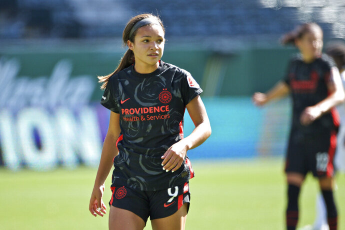 In this photo provided by the Portland Thorns, Portland Thorns' Sophia Smith looks on during an NWSL soccer match against Utah on Sunday, Sept. 20, 2020, in Portland, Ore. The No. 1 pick in the National Women's Soccer League draft and U.S. national team prospect, Smith comes from a family of basketball players — and it was just assumed she'd head in the same direction. Turned out Smith was right to choose soccer. It paved her way to Stanford, and now to a career in the NWSL.   (Craig Mitchelldyer/Portland Thorns via AP)