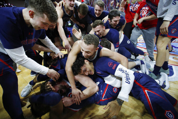 St. Mary's Jordan Ford, center, and teammates celebrate after defeating Gonzaga 60-47 in an NCAA college basketball game for the West Coast Conference men's tournament title, Tuesday, March 12, 2019, in Las Vegas. (AP Photo/John Locher)