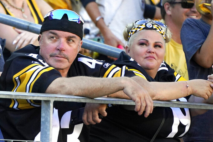 Pittsburgh Steelers fans watch as their team is losing to the Cincinnati Bengals during the second half an NFL football game, Sunday, Sept. 26, 2021, in Pittsburgh. The Bengals won 24-10. (AP Photo/Gene J. Puskar)
